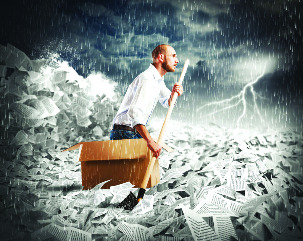 45734323 - concept of bureaucracy with man paddling in a sea of sheets