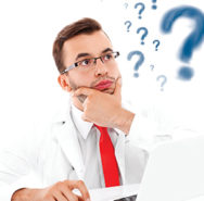 33006685 - a picture of an unhappy doctor with laptop and documents sitting in the office