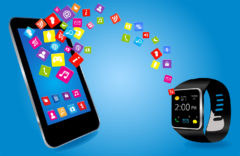 Smartwatch and Smart phone with colorful Application Icons sharing