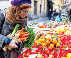 35115152 - young woman buying vegetables at local market